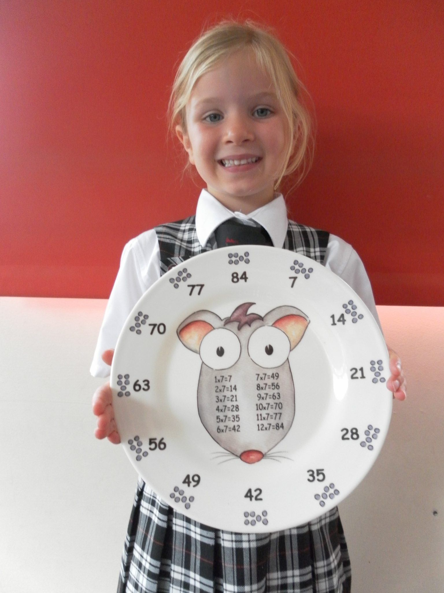 Every lunchtime the Pre-Prep children are now racing through their meal so that they can see which of the 12 different characters is printed on their plate! Each of the times tables has its own character: pictured here with Lowenna (Year 2 CP) is Tiny Seven Squeaks; Madame Two Moos and Goatee Ten Beards are firm favourites already.