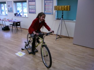 Zillyan pedaling hard to light up the word SCIENCE